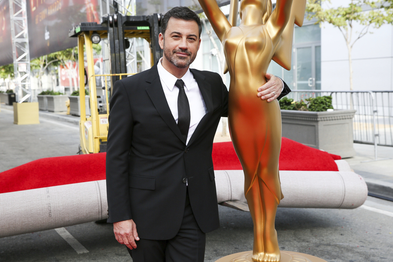 FILE – This Sept. 14, 2016 file photo shows host Jimmy Kimmel posing for a photo with a replica of an Emmy statue at the Primetime Emmy Awards Press Preview Day in Los Angeles. Kimmel will return as host and will serve as executive producer for the 72nd Emmy Awards. The show will be broadcast, Sunday, Sept. 20, on ABC. (Photo by Rich Fury/Invision/AP, File)