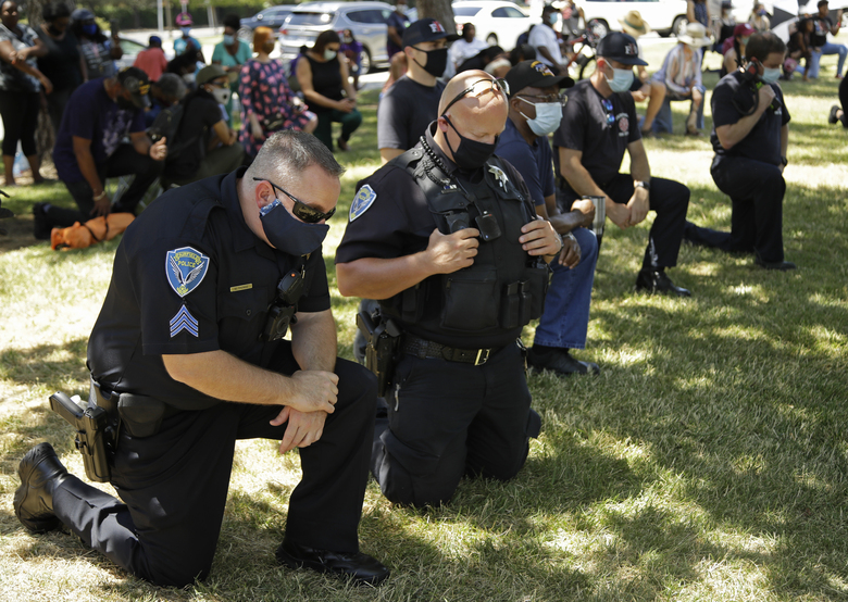 "Fairfield police officers kneel during ""Taking a knee for Justice and Prayer"" service on Wednesday, June 3, 2020, in Fairfield, Calif. (AP Photo/Ben Margot)"