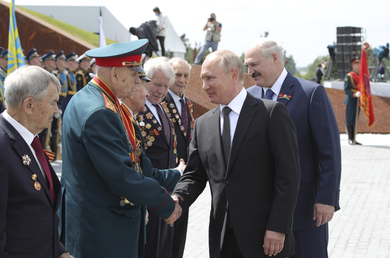 Russian President Vladimir Putin, second right, and Belarusian President Alexander Lukashenko, right, greet a group  ofWWII veterans during an opening ceremony of the monument to World War II Red Army soldiers seen in the background, Russia, Tuesday, June 30, 2020. Putin urged voters to cast ballots in a constitutional vote wrapping up Wednesday that could allow him to extend his rule until 2036. (Mikhail Klimentyev, Sputnik, Kremlin Pool Photo via AP)