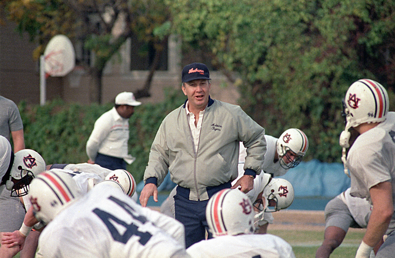 FILE – In this Dec. 27, 1988, file photo, Auburn NCAA college football coach Pat Dye walks through his players as they begin workouts in preparation for the Sugar Bowl in New Orleans. Former Auburn coach Pat Dye, who took over a downtrodden football program in 1981 and turned it into a Southeastern Conference power, has died. He was 80. Lee County Coroner Bill Harris said Dye passed away Monday, June 1, 2020, at the Compassus Bethany House in Auburn, Ala.(AP Photo/Bill Haber, FIle)