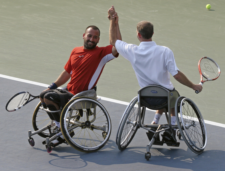 FILE – In this Sept. 9, 2006, file photo, Michael Jeremiasz, of France, left, and Robin Ammerlaan, of the Netherlands, celebrate after defeating Shingo Kunieda, of Japan, and Tadeusz Kruszelnicki, of Poland, in the men's wheelchair doubles final at the U.S. Open Tennis tournament in New York. The U.S. Tennis Association changed its plans and now will include wheelchair competition at the scaled-down U.S. Open after athletes complained about the original decision to drop their event entirely this year. The USTA announced Wednesday, June 24, 2020, that wheelchair tennis will be played at Flushing Meadows from Sept. 10-13, the last four days of the Grand Slam tournament.(AP Photo/Mary Schwalm, File)