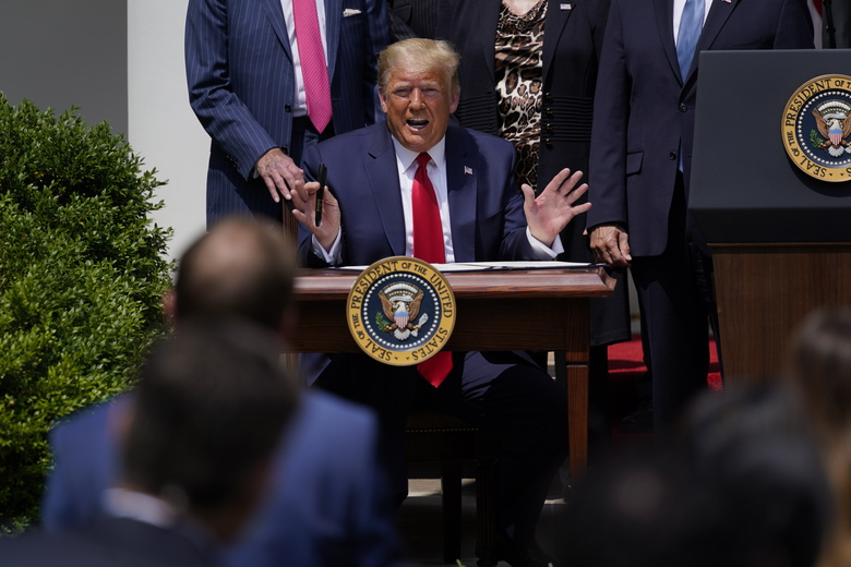 President Donald Trump speaks as he signs the Paycheck Protection Program Flexibility Act during a news conference in the Rose Garden of the White House, Friday, June 5, 2020, in Washington. (AP Photo/Evan Vucci)