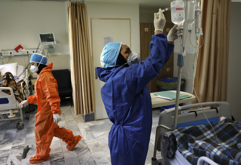 Nurses tend to COVID-19 patients at the Shohadaye Tajrish Hospital in Tehran, Iran. After months of fighting the coronavirus, Iran just saw its highest single-day spike in reported cases after Eid al-Fitr, the holiday that celebrates the end of Ramadan. (AP Photo / Vahid Salemi, file)
