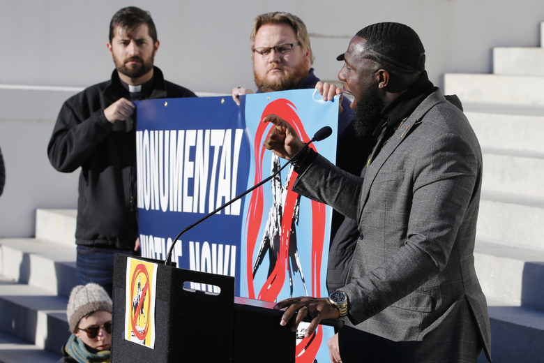 FILE – In this Jan. 8, 2020, file photo former Charlottesville City Councilman, Wes Bellamy, right, gestures as he speaks to demonstrators in front of the Capitol steps to support the removal of Confederate monuments at the Capitol in Richmond, Va. Bellamy said when he first started raising the issue of removing Confederate monuments, black and white people alike across Virginia told him he was just causing trouble. (AP Photo/Steve Helber, File)