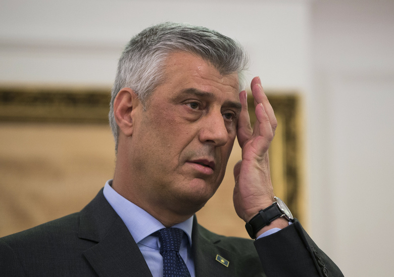 FILE – In this Monday, Jan. 21, 2019 file photo, Kosovo president Hashim Thaci gestures during a press conference in Kosovo capital Pristina. Kosovo's president and nine other former separatist fighters were indicted on a range of crimes against humanity and war crimes charges, including murder, by a court investigating crimes against ethnic Serbs during and after Kosovo's 1998-99 independence war with Serbia, it was reported on Wednesday, June 24, 2020. (AP Photo/Visar Kryeziu, File)