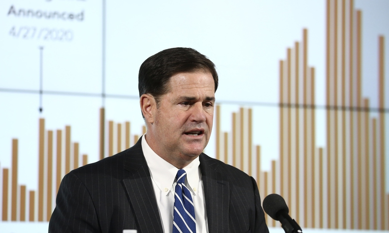 Arizona Republican Gov. Doug Ducey announces the latest coronavirus numbers and recent spike in cases during a news conference Thursday, June 11, 2020, in Phoenix. (AP Photo/Ross D. Franklin, Pool)