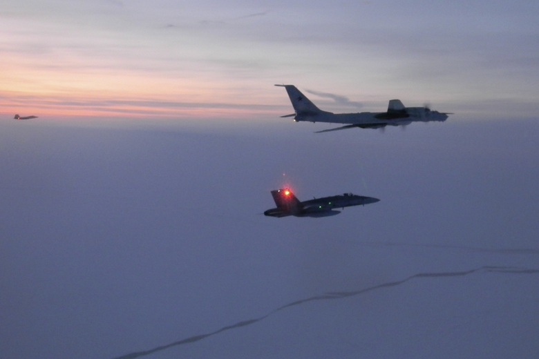 FILE – In this Monday, March 9, 2020 file photo released by the North American Aerospace Defense Command (NORAD), a Russian Tu-142 maritime reconnaissance aircraft, top right, is intercepted near the Alaska coastline. Two Russian aircraft that came within 50 miles (80 kilometers) of Unimak Island along Alaska's Aleutian chain were intercepted late Wednesday, June 24, 2020, military officials said Thursday. The incident marked the fifth time this month that such an intercept has taken place, Gen. Terrence J. O'Shaughnessy, commander of the North American Aerospace Defense Command, said in a release. (North American Aerospace Defense Command via AP,File)