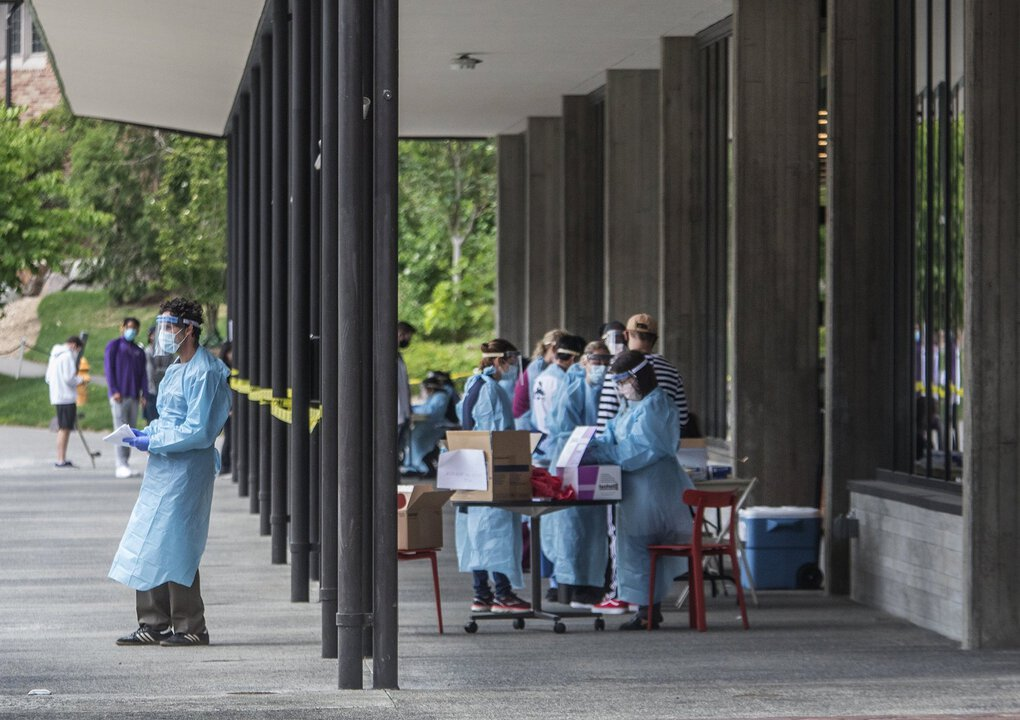 A COVID-19 testing site is set up outside Madrona Hall on the University of Washington campus on Thursday. (Steve Ringman / The Seattle Times)