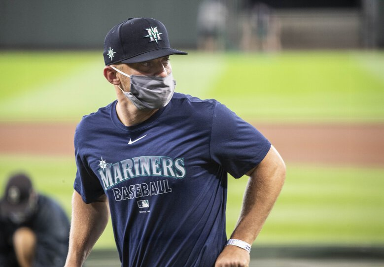 Kyle Seager is in a mask as he takes the field for Summer Camp on Friday at T-Mobile Park in Seattle. (Dean Rutz / The Seattle Times)