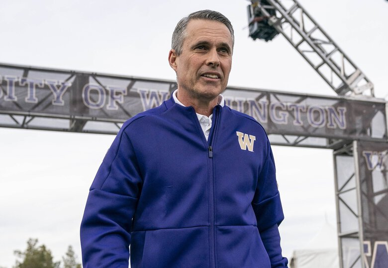 Chris Petersen heads out to the field for his final game as Washington's head coach.   (Dean Rutz / The Seattle Times)