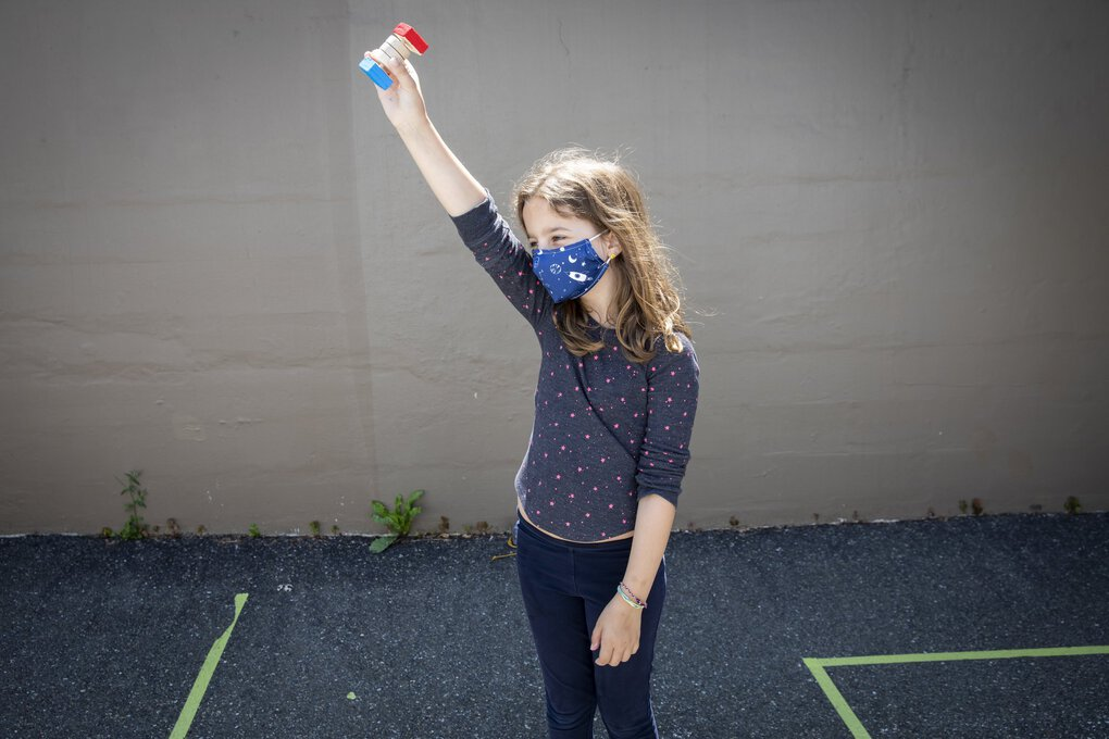 Hannah Goldberg, 9, holds her handmade wooden scorekeeper while the paint dries during a half-day summer camp class with Kids' Carpentry Seattle in the Columbia City neighborhood Friday. (Bettina Hansen / The Seattle Times)