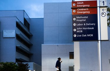 "FILE — A health care worker arrives at Methodist Hospital in San Antonio, June 28, 2020. A 30-year-old man who believed the coronavirus was a hoax and attended a ""Covid party"" died after being infected with the virus, according to a Texas hospital. (Christopher Lee/The New York Times) XNYT14 XNYT14"