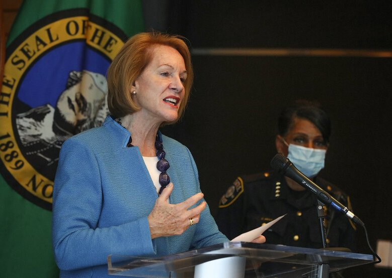Seattle Mayor Jenny Durkan and Seattle police Chief Carmen Best address the media at a news conference June 11  at City Hall.  Durkan has asked a King County judge to reconsider her ruling to allow a recall petition to proceed against the mayor, arguing the use of tear gas to disperse protesters was a decision made by  Best, not Durkan, and that it was a reasonable one. (Greg Gilbert / The Seattle Times)
