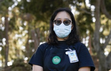 Katie Doan, a former Whole Foods employee, poses for a photo Thursday, July 16, 2020, in Costa Mesa, Calif. Doan started tracking COVID-19 cases at Amazon-owned Whole Foods in April. (AP Photo/Ashley Landis) CAAL101 CAAL101