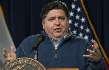 FILE – In this April 17, 2020, file photo, Illinois Gov. J.B. Pritzker speaks during his daily coronavirus news conference in Chicago. Pritzker took the unusual step Thursday, July 16, of preemptively filing a lawsuit to ensure school children wear face coverings to prevent the spread of the coronavirus when schools reopen in a few weeks. (Tyler LaRiviere/Chicago Sun-Times via AP, File) ILCHS501 ILCHS501