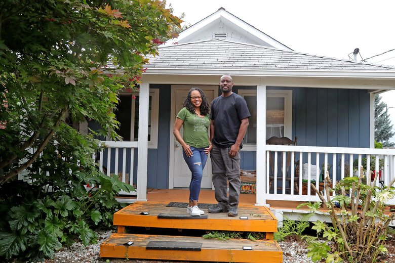 The city of Seattle has demanded that Erika Cherry and her husband, Andre, pay $11,000 to the city's affordable housing fund because their home-renovation project was extensive enough to qualify as new construction. (Greg Gilbert / The Seattle Times)