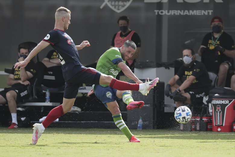 Seattle Sounders midfielder Nicolas Lodeiro, right, takes a shot on goal as Chicago Fire midfielder Fabian Herbers, left, tries to block the shot during the first half of an MLS soccer match, Tuesday, July 14, 2020, in Kissimmee, Fla. (John Raoux / The Associated Press)