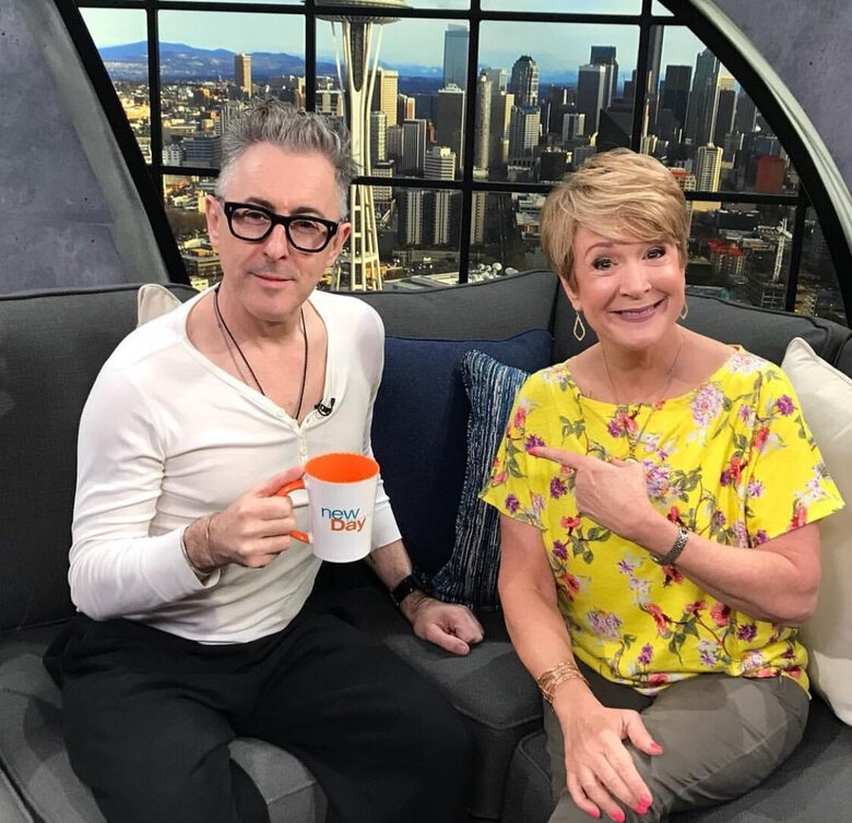 "KING 5 host Margaret Larson interviews actor Alan Cumming on the set of ""New Day Northwest."" Larson is retiring on July 30 after 38 years in journalism. (Courtesy of King 5)"