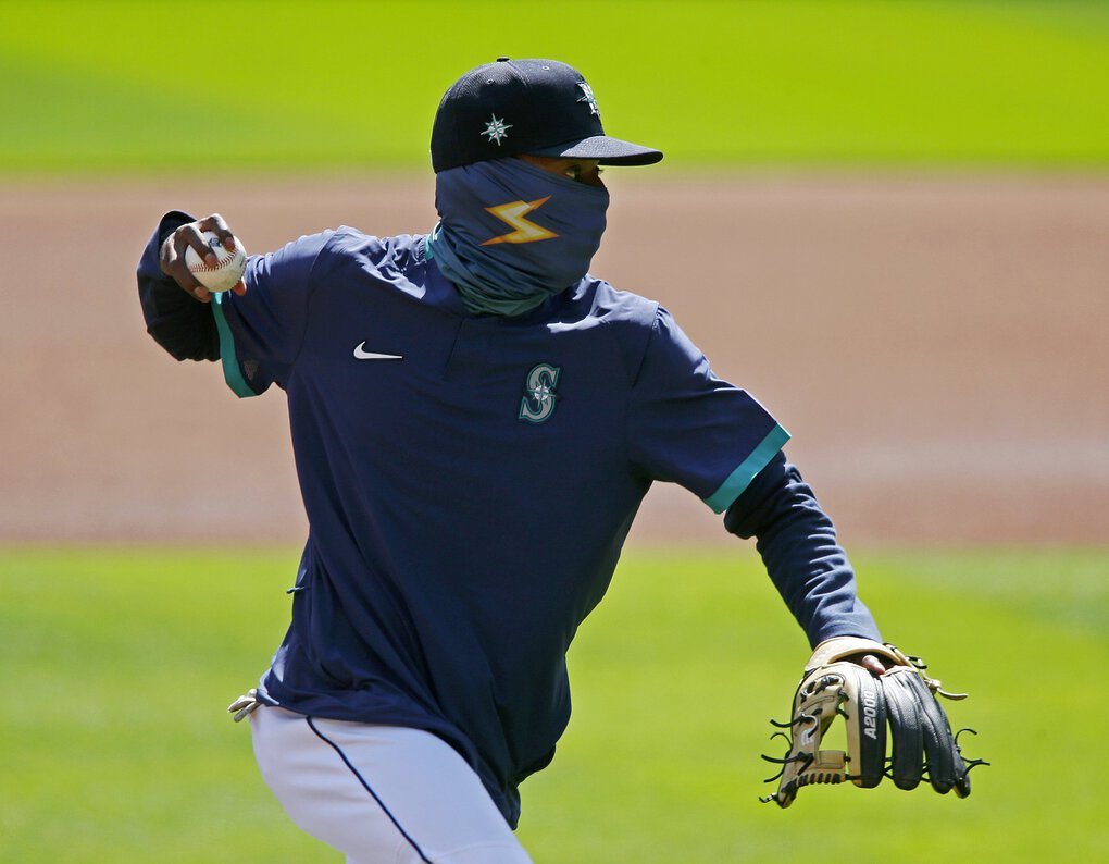 """Second baseman Dee Gordon works on a drill during the third day of Mariners """"Summer Camp"""" Sunday at T-Mobile Park. (Ken Lambert / The Seattle Times)"""