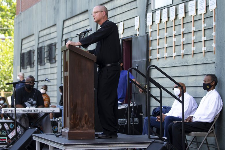 "Seattle Archbishop Paul Etienne addresses a crowd gathered from local parishes for an outdoor prayer vigil for racial justice at Immaculate Conception Church in the Central District neighborhood of Seattle on Sunday. Etienne acknowledged that as a white man, he does not share the burden of the Black community, but as a pastor, wishes to listen. ""Some people say I didn't own slaves, I'm not a racist,"" he said. ""We can take our example from Good Friday … we all take ownership in our role for crucifying Jesus."" (Bettina Hansen / The Seattle Times)"