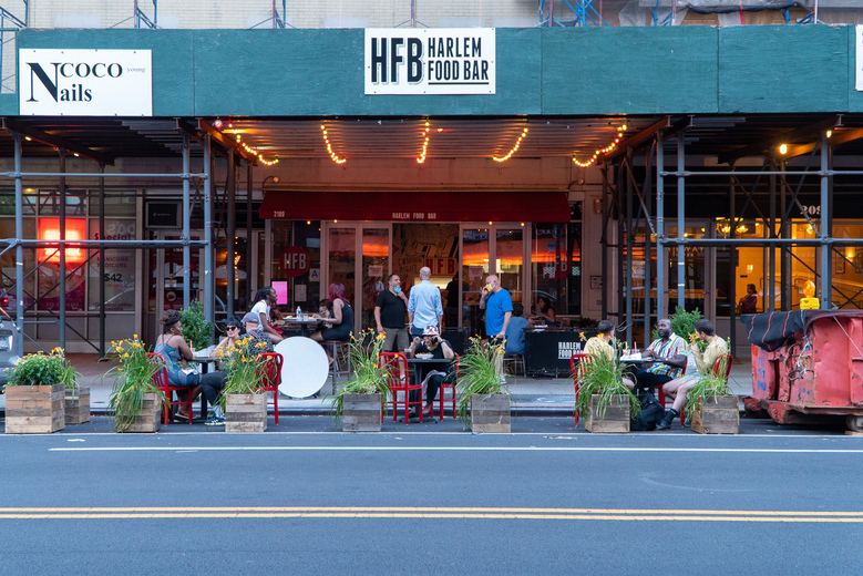 Outdoor dining area at Harlem Food Bar in New York. With the coronavirus spreading rapidly in other large states like Florida and Texas, Mayor Bill de Blasio announced on July 1, that New York City would not resume indoor dining at restaurants next week as anticipated. (Emon Hassan / The New York Times)