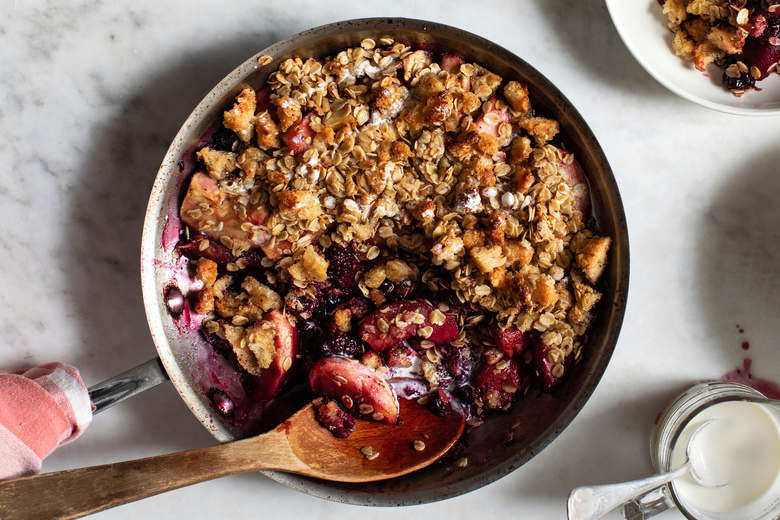 Skillet berry and brown-butter toast crumble in New York on June 30, 2020. What started out as French toast, a morning favorite at Yotam Ottolenghi's house, evolved into this warm, fruity treat. (Andrew Scrivani/The New York Times)