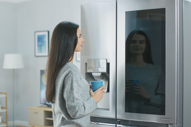 Some refrigerator models include a tinted glass panel that illuminates to see inside the fridge compartment without opening the door. (Courtesy MBAKS)