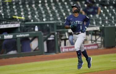 Seattle Mariners' Kyle Lewis runs toward home plate after hitting a home run against the Houston Astros during the second inning of a baseball game Friday, July 24, 2020, in Houston. (AP Photo/David J. Phillip) TXDP136 TXDP136