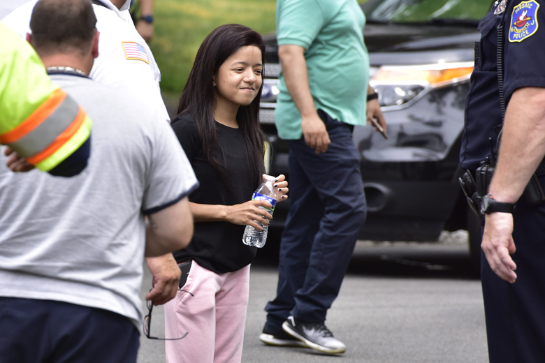 Nathalia Bruno, 24, of Newark, returns to Passaic, NJ., on Wednesday, July 8, 2020 to see her car in the storm drain. Emergency personnel searched and found a Toyota Prius that was swept away into a canal on Monday July 6, 2020 in Passaic, N.J. Nathalia Bruno survived a mile-long ride through a storm drain after a flash flood swept her and her car into the local drainage system. The car was found on Wednesday. (Tariq Zehawi/The Record via AP)