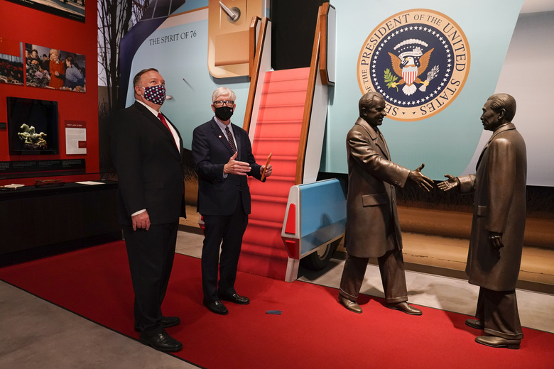 Secretary of State Mike Pompeo, left, tours the Richard Nixon Presidential Library with Hugh Hewitt, president and CEO of the Nixon Foundation, Thursday, July 23, 2020, in Yorba Linda, Calif. (AP Photo/Ashley Landis, Pool)