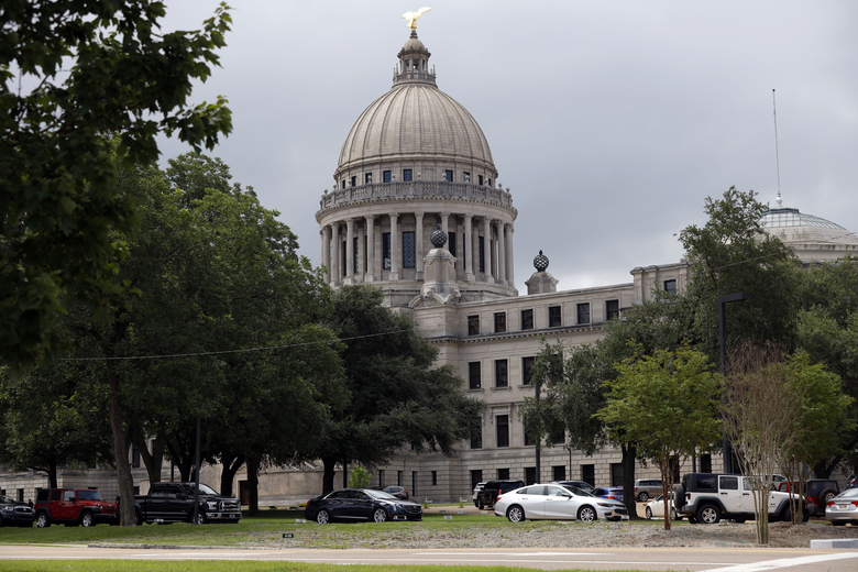 FILE – In this July 6, 2020, file photo, Mississippi legislators, staff and Capitol employees take advantage of a drive-thru COVID-19 testing center on the Capitol grounds in Jackson, Miss. Mississippi is seeing the largest outbreak of COVID-19 among legislators in any state. (AP Photo/Rogelio V. Solis, File)