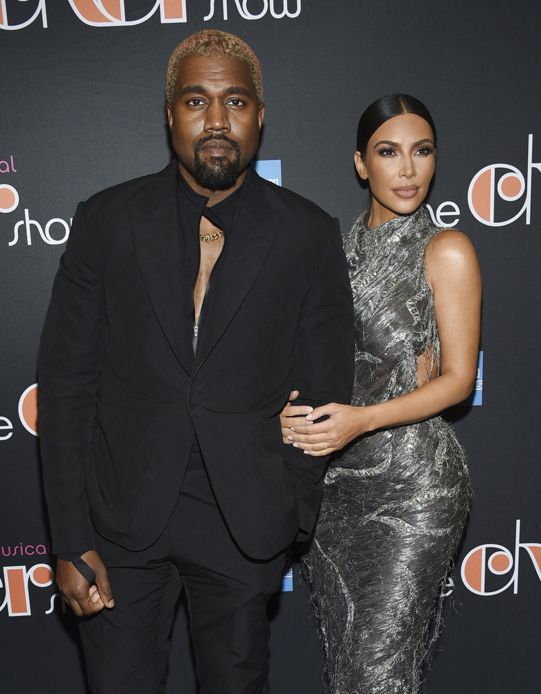 "FILE – Kanye West, left, and his wife Kim Kardashian West attend ""The Cher Show"" Broadway musical opening night at the Neil Simon Theatre in New York on Dec. 3, 2018. Kardashian West is asking the public to show compassion and empathy to husband Kanye West, who she says is bipolar and caused a stir this week after fulminating in a series of social media posts. The reality TV star posted a lengthy message Wednesday on her Instagram Live feed, explaining that life has been complicated for her family and West, who ranted against historical figure Harriet Tubman and discussed abortion on Sunday while he declared himself a presidential candidate. (Photo by Evan Agostini/Invision/AP, File)"
