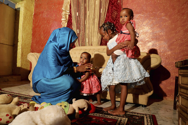 "Youssria Awad plays with her daughters in their home, in Khartoum, Sudan on  June 14, 2020. She refuses to carry out female genital mutilation on them, a practice that involves partial or total removal of the external female genitalia for non-medical reasons that The World Health Organization says FGM constitutes an ""extreme form of discrimination"" against women. (AP Photo/Marwan Ali)"