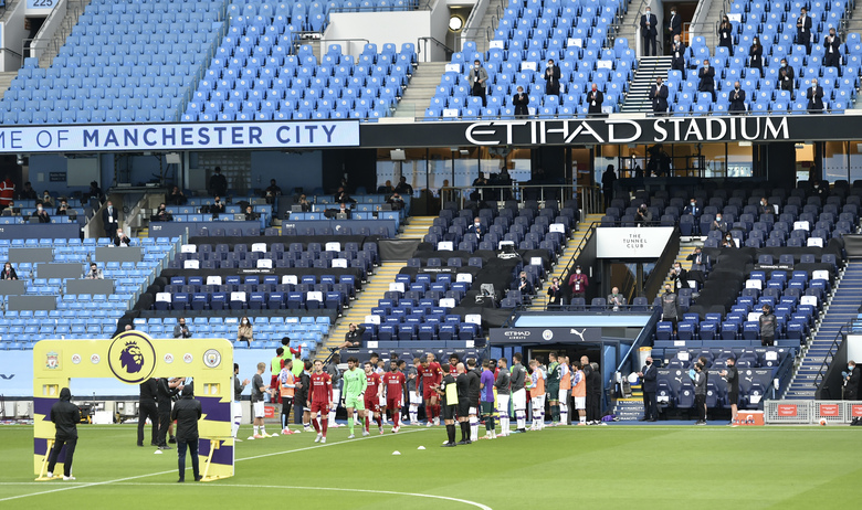 Liverpool players walk through a guard of honor from the Manchester City team ahead of their English Premier League soccer match between Manchester City and Liverpool at Etihad Stadium in Manchester, England, Thursday, July 2, 2020. (AP Photo/Peter Powell,Pool)