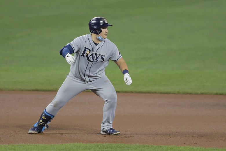 Tampa Bay Rays' Ji-Man Choi returns to second base after hitting a double during the seventh inning of a baseball game against the Baltimore Orioles, Friday, July 31, 2020, in Baltimore. (AP Photo/Julio Cortez)