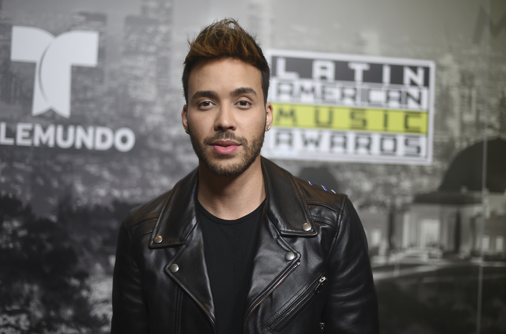 In this file photo from Oct. 26, 2017, Prince Royce poses backstage at the Latin American Music Awards in Los Angeles, where he won four awards. Royce says he got a wake-up call with a COVID-19 diagnosis and now wants to try and wake others too. The Latin star told The Associated Press on Thursday that he is recovering from the virus. He says he decided to speak up out of a growing frustration with seeing people going out and gathering without protection. (Photo by Richard Shotwell/Invision/AP, File)
