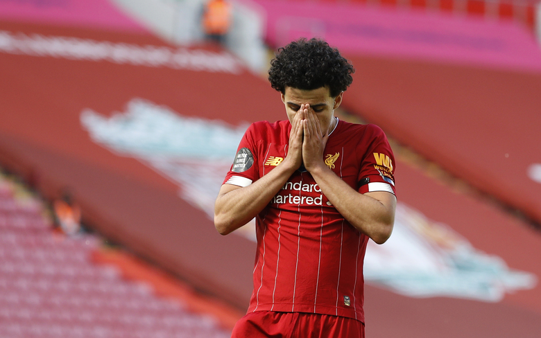 Liverpool's Curtis Jones reacts after missing a chance to score during the English Premier League soccer match between Liverpool and Burnley at Anfield in Liverpool, England, Saturday, July 11, 2020. (Phil Noble/Pool via AP)