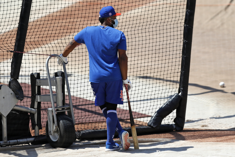 New York Mets' Robinson Cano leans on his bat as he waits his turn in the cage during baseball practice at Citi Field, Thursday, July 16, 2020, in New York. (AP Photo/Kathy Willens)