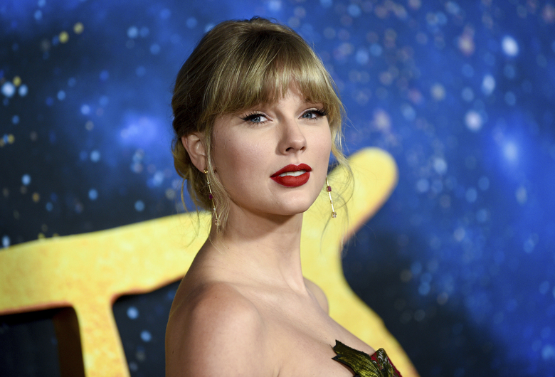 """FILE – Singer-actress Taylor Swift attends the world premiere of """"Cats"""" in New York on Dec. 16, 2019. Swift has a new album coming out on Friday called """"Folklore."""" She says the standard edition will include 16 tracks and the album will feature Bon Iver, Aaron Dessner of The National and frequent collaborator Jack Antonoff.  (Photo by Evan Agostini/Invision/AP, File)"""