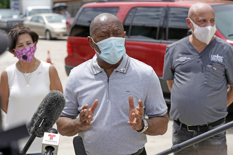 Houston Mayor Sylvester Turner speaks at a free coronavirus testing site provided by United Memorial Medical Center at the Mexican Consulate Sunday, June 28, 2020, in Houston. Top officials in Houston are calling for the city to lock back down as area hospitals strain to accommodate the onslaught of patients sick with COVID-19. Mayor Turner and Harris County Judge Lina Hidalgo, both Democrats, said this weekend that a stay-at-home order is needed for America's fourth-largest city to cope with the surge of COVID-19 cases. (AP Photo/David J. Phillip, File)