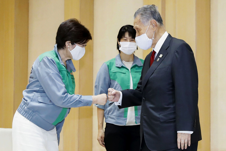 Tokyo's newly reelected Gov. Yuriko Koike, left, meets Tokyo 2020 President Yoshiro Mori at Tokyo Metropolitan Government headquarters in Tokyo Monday, July 6, 2020. Koike assured Mori that she plans to continue working with him on achieving the games, and agreed to his proposal to set up a meeting among officials from the government, Tokyo and Olympic organizers to discuss COVID-19 countermeasures. (Kyodo News via AP)