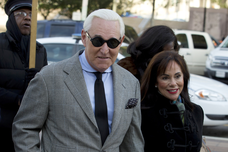 FILE – In this Nov. 14, 2019, file photo, Roger Stone accompanied by his wife Nydia Stone, right, arrives at federal court in Washington. (AP Photo/Jose Luis Magana, File)