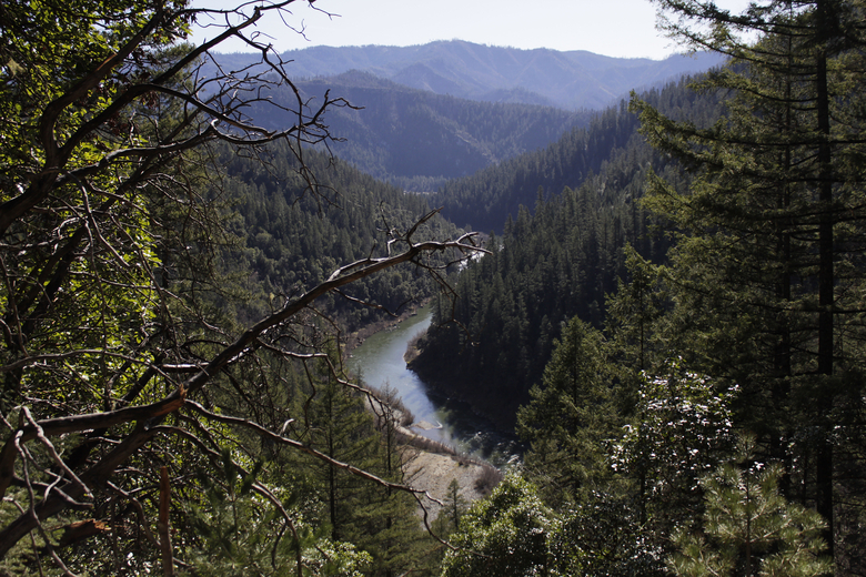 FILE – In this March 3, 2020, file photo, the Klamath River is seen flowing across northern California from atop Cade Mountain in the Klamath National Forest. California Gov. Gavin Newsom has appealed directly to investor Warren Buffet to support demolishing four hydroelectric dams on a river along the Oregon-California border to save salmon populations that have dwindled to almost nothing. Newsom on Wednesday, July 28, 2020, wrote Buffet, urging him to back the Klamath River project, which would be the largest dam removal in U.S. history. (AP Photo/Gillian Flaccus, File)