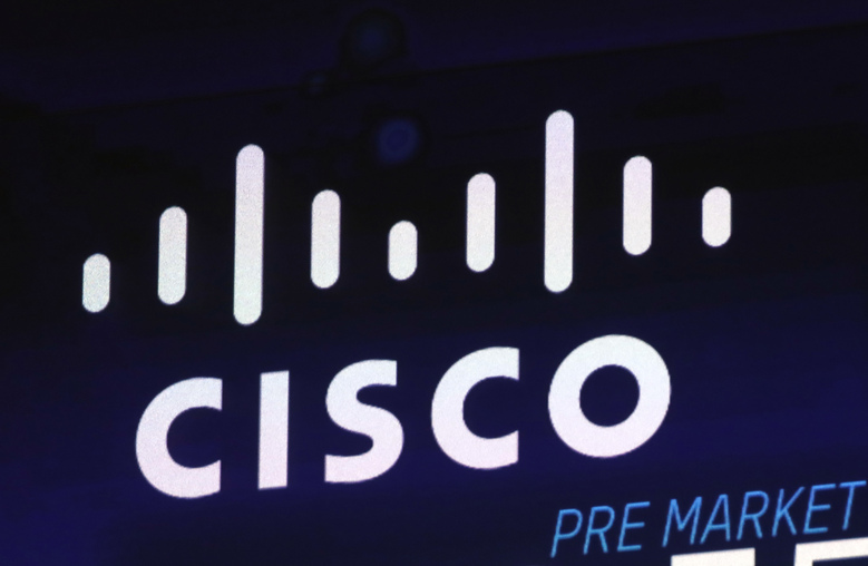 FILE – In this Oct. 3, 2018, file photo, the Cisco logo appears on a screen at the Nasdaq MarketSite in New York's Times Square. California regulators have sued Cisco Systems for discriminating against an engineer at the company's headquarters because he is a Dalit Indian. India's caste system has long placed Dalits at the bottom of a social hierarchy. California's lawsuit says Cisco broke the Civil Rights Act of 1964 and California's Fair Employment and Housing Act. (AP Photo/Richard Drew, File)