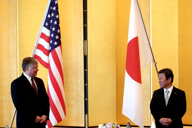 U.S. Deputy Secretary of State Stephen Biegun, left, and Japan's Foreign Minister Toshimitsu Motegi greet each other prior to their bilateral meeting in Tokyo Friday, July 10, 2020. (Behrouz Mehri/Pool Photo via AP)