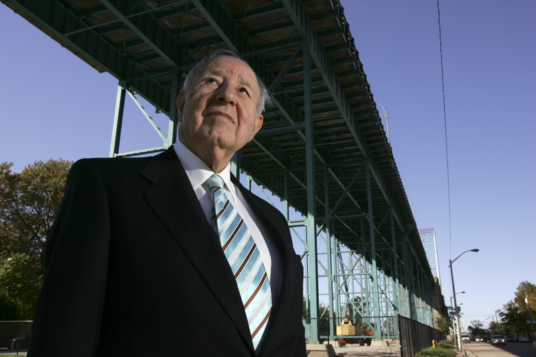 """FILE — Manuel """"Matty"""" Moroun stands under at the Ambassador Bridge in Windsor, Ontario, Canada May 18, 2000.   Moroun, a billionaire businessman who owned a critical bridge that connects Michigan to Canada, has died in his suburban Detroit home. He was 93. Moroun died of congestive heart failure Sunday, July 12, 2020, in Grosse Pointe Shores. (Max Ortiz/Detroit News via AP)"""