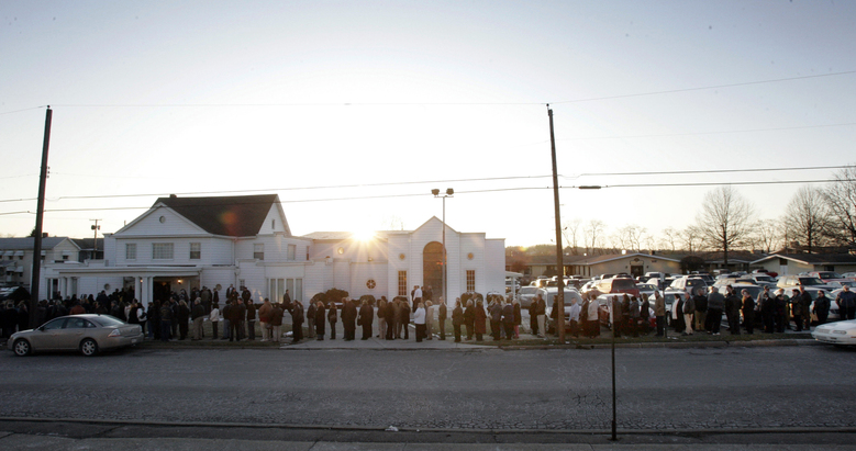 FILE – In this Feb. 24, 2009, file photo, the sun goes down behind the funeral home as mourners line up for the funeral of Kenzie Houk in New Castle, Pa. Jordan Brown, who was eleven-years-old at the time, was charged in the shooting death of the 26-year-old pregnant mother of two. On Wednesday, July 1, 2020, Brown and his attorneys filed a wrongful prosecution and conviction lawsuit, alleging that state police investigators manipulated interviews, evidence and procedures to push the narrative that Brown had killed his soon-to-be stepmom. (AP Photo/Keith Srakocic, File)