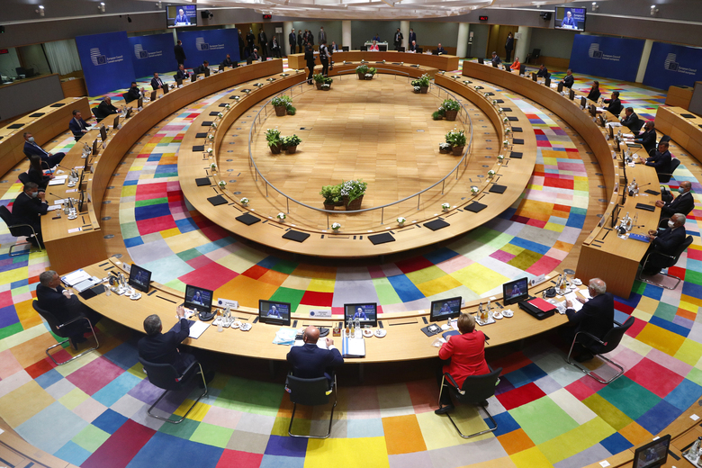 European Union leaders during a round table meeting at an EU summit in Brussels, Friday, July 17, 2020. Leaders from 27 European Union nations meet face-to-face on Friday for the first time since February, despite the dangers of the coronavirus pandemic, to assess an overall budget and recovery package spread over seven years estimated at some 1.75 trillion to 1.85 trillion euros. (Francois Lenoir, Pool Photo via AP)