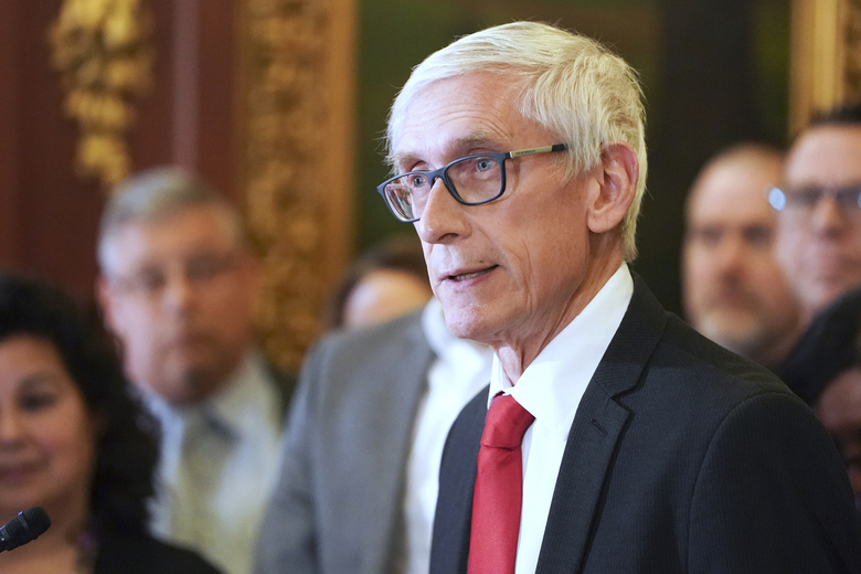 FILE – In this Feb. 6, 2020, file photo, Wisconsin Gov. Tony Evers holds a news conference in Madison, Wis. The conservative-controlled Wisconsin Supreme Court on Friday, July 10, 2020, overturned three of four partial budget vetoes issued by Democratic Gov. Tony Evers, bucking decades of court precedent that upheld the governor's broad veto powers. However, the justices also upheld one of Evers' vetoes and declined to consider a challenge to a pair of partial vetoes issued by Republican Gov. Scott Walker in 2017, saying the 2019 lawsuit was filed too late.(Steve Apps/Wisconsin State Journal via AP, File)