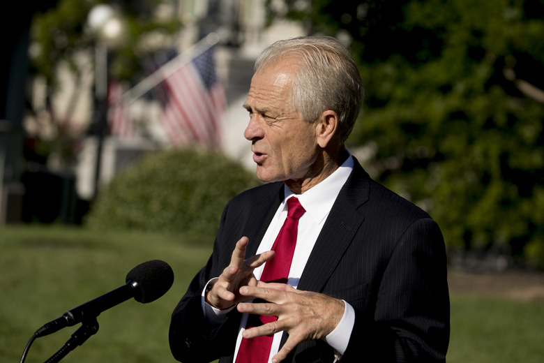 White House trade adviser Peter Navarro speaks with reporters outside the West Wing at the White House in Washington, Monday, July 27, 2020. (AP Photo/Andrew Harnik)